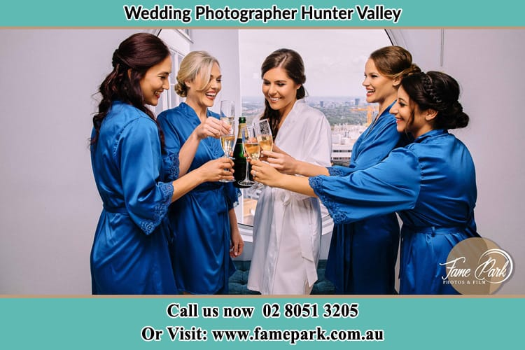 Photo of bride with bridesmaids celebrating with champaign Hunter Valley