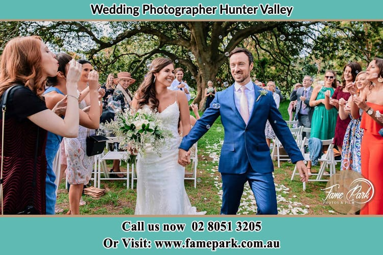 Photo of bride and groom holding hands after wedding Hunter Valley